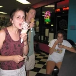 The girls throughly enjoyed their ice cream.