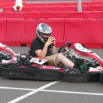 Allen takes to the track in a go-kart.